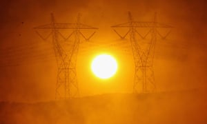 Sun shines between power lines
