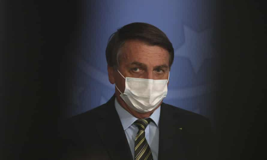 Jair Bolsonaro threatened a reporter on Sunday when he asked the president to explain why a former policeman with alleged links to Rio's mafia had paid thousands of pounds into the bank account of his wife.