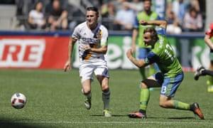 Robbie Keane of LA Galaxy, left, eludes the Seattle Sounders midfielder Jordan Morris, right, in the teams' MLS clash in July.