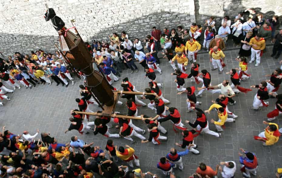 The Ceraioli run through the streets of Gubbio, Italy.