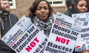 Protesters in London in 2017 hold placards saying 'Money for education not racist deportations'