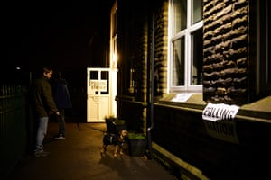 Early morning voters arrive before dawn at a polling station at Hazlehurst primary school in the marginal Bury North constituency