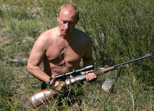 August 2007: Putin is pictured carrying a hunting rifle in the Republic of Tuva