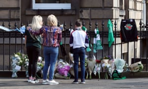 People view floral tributes on Chester Street in Edinburgh.