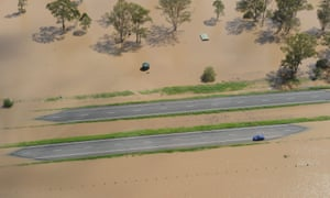 A car is stranded in flood waters on the Warrego Highway west of Brisbane, Australia on 12 January 2011.