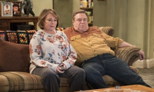 Roseanne Barr and John Goodman in a scene from the reboot of TV show Roseanne. The debut episode was watched by 18.4 million people.
