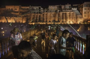 Ethnic Uighurs watch a laser and water show as part of a local government tourism development in the old town of Kashgar in Xinjiang province, China. Kashgar has long been considered the cultural heart of Xinjiang for the province's nearly 10 million Muslim Uighurs