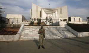 A paramilitary soldier stands guard outside the supreme court building in Islamabad.