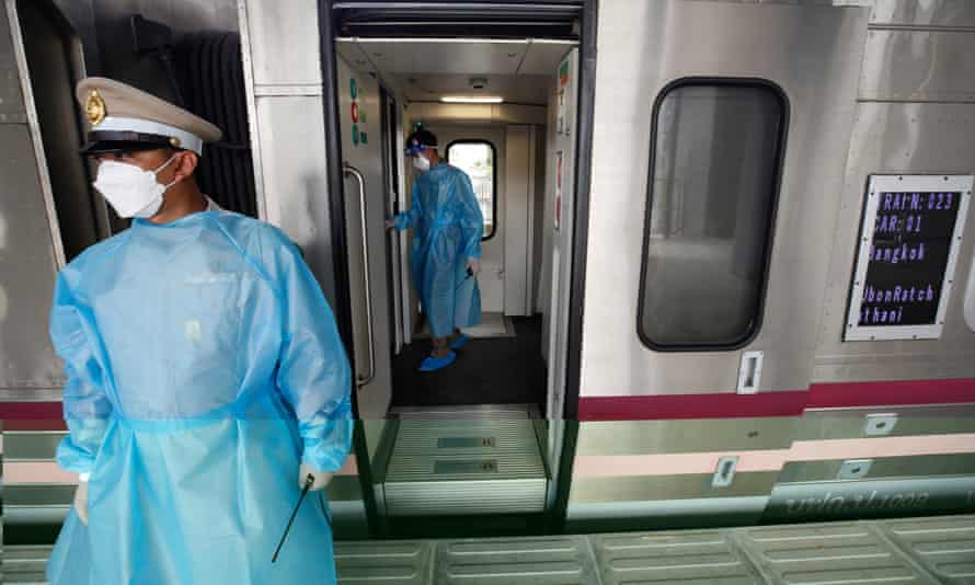 Thai railway police patrol a passenger train while waiting for Covid-19 patients in Bangkok.