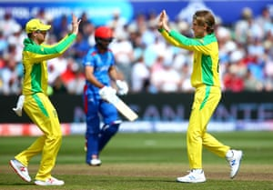 Zampa celebrates with Smith after dismissing Rahmat for 43.