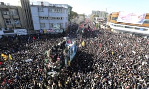 Coffins of Qassem Soleimani and others who were killed in Iraq by a US drone strike, are carried on a truck surrounded by mourners during a funeral procession, in the city of Kerman, Iran.