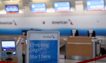 The American check-in desk at Dallas-Forth Worth airport. The five airlines are pushing for a $50bn-plus bailout package to help them deal with the economic effects of the coronavirus.