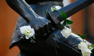 White roses adorn a statue of Richard III outside Leicester cathedral