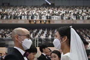 Couple facing each other, wearing face masks