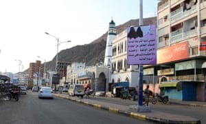Banners hung by al-Qaida militants announcing Islamists' orders line the streets in the Yemeni port of Mukalla, in the Hadramawt province, on Tuesday.