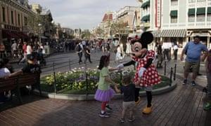 Minnie Mouse dances with visitors at Disneyland in Anaheim, Calif. (AP Photo/Jae C. Hong)