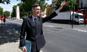 Jacob Rees-Mogg hails a taxi in Whitehall, London.