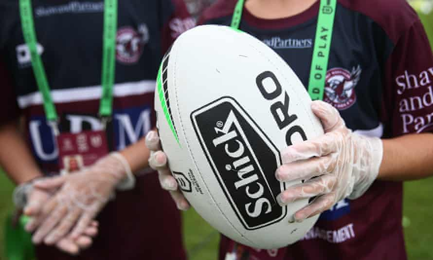 Ball boys wear gloves while holding the match ball during Round 1 NRL matches this weekend.