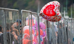 Balloons welcome friends and family of those lost on White Island as they arrive back into Whakatane after traveling on a White Island Tours boat for a blessing out at sea in Whakatane.