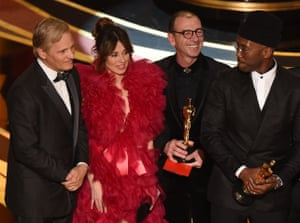 Green Book cast members Viggo Mortensen, Linda Cardellini and US actor Mahershala Ali celebrate their best picture award onstage.