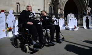 Campaigners against assisted suicide outside the Royal Courts of Justice in London.