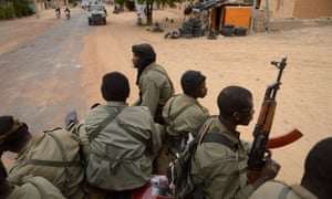 Malian soldiers enter the historic city of Timbuktu in 2013. New internal documents show a significant volume of Australian arms exports went to Mali last year. The country has been gripped by near-perpetual internal conflict for eight years.