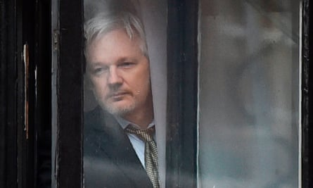 Julian Assange goes out to the balcony of the Ecuadorian embassy in 2016