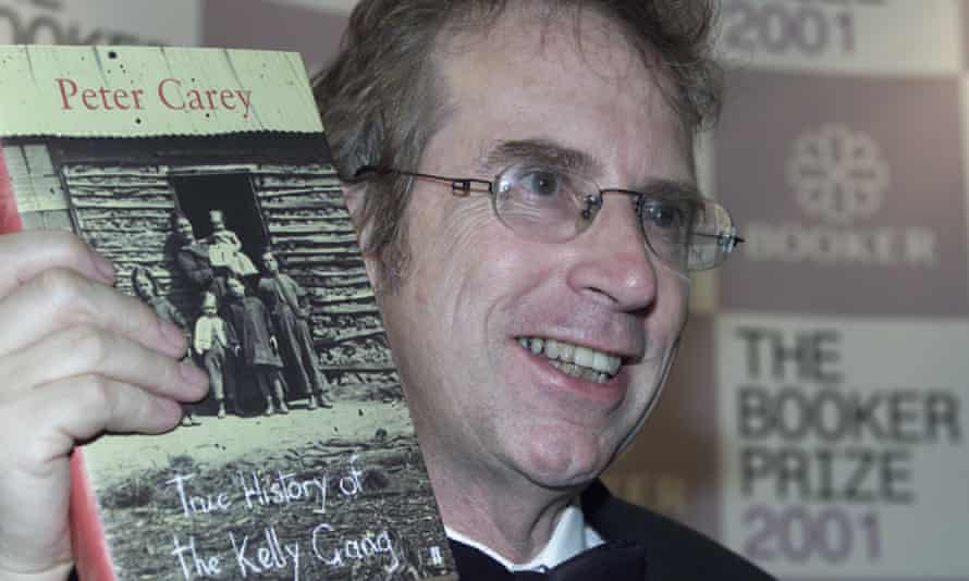 Peter Carey poses after winning the Booker prize for fiction in 2001 for True History of the Kelly Gang.