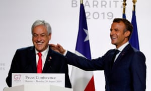Chile's President Sebastian Pinera (left) speak during a joint press conference focused on climate issues in Biarritz with President Emmanuel Macron of France