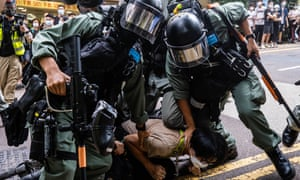 Riot police pin down a protester during a pro-democracy demonstration in Hong Kong on 1 July