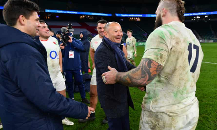 Eddie Jones shakes hands with Joe Marler after England beat France to win the Autumn Nations Cup.