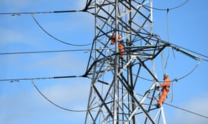 Workers on a high-tension electricity pylon