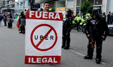Taxi drivers protest against Uber in Bogota. Photograph: EPA/Leonardo Munoz