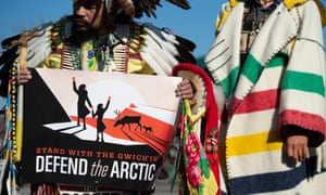 Native American leaders hold signs against drilling in the Arctic Refuge