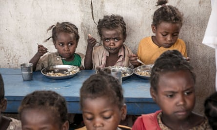 Schoolchildren in the Amboasary-South district of Madagascar eat lunch provided by the World Food Programme.