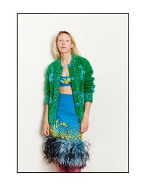 Maggie wears a mohair cardigan, £2,915, top, £730, feather-trimmed skirt, £1,890, and boots, £1,780, from PradaMaggie Maurer's hair and makeup was done by Julia Sergot using Bumble and bumble and MACModel agency: IMG