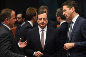 Eurogroup Jeroen Dijsselbloem (right) speaks before European Central Bank President Mario Draghi (centre)