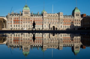 London, UK: Admiralty House is reflected in a puddle on Horse Guards Parade