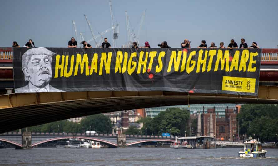 Amnesty International drops a banner from Vauxhall Bridge opposite the US embassy in London in a protest against Donald Trump's visit to the United Kingdom last July