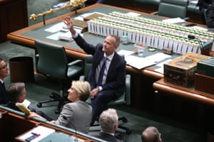 Opposition leader Bill Shorten waves to schoolchildren during a division in question time in the House of Representatives
