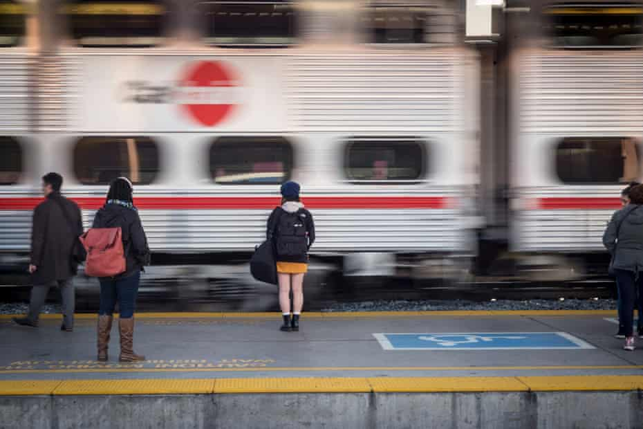 Commuters wait on a train platform at San Jose's Diridon station in San Jose, California.