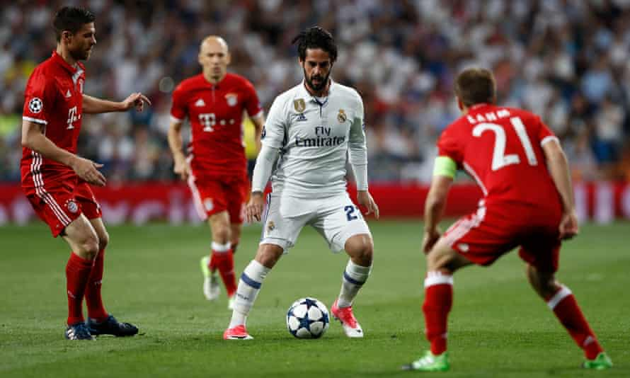 Bayern Munich's Xabi Alonso, left, Philipp Lahm and Arjen Robben, rear, keep an eye on Real Madrid's Isco