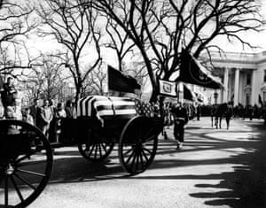 The casket bearing the body of John F Kennedy as he leaves the White House for the final time in Washington on 25 November 1963