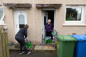 Peacock delivers food parcels to Rena Quinn, a Craigend resident.