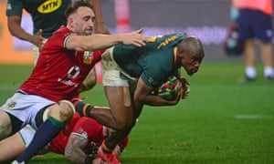 Makazole Mapimpi of South Africa scores a try despite the efforts of Jack Conan of the British and Irish Lions.
