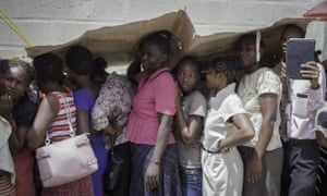 People queue for a medical consultation near St Luke's Family hospital in Tabarre, Haiti.