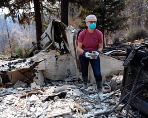 Nancy Chamberlin searches for belongings in her home in Shasta.