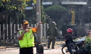 Indonesian bomb squad member approaches church in Surabaya