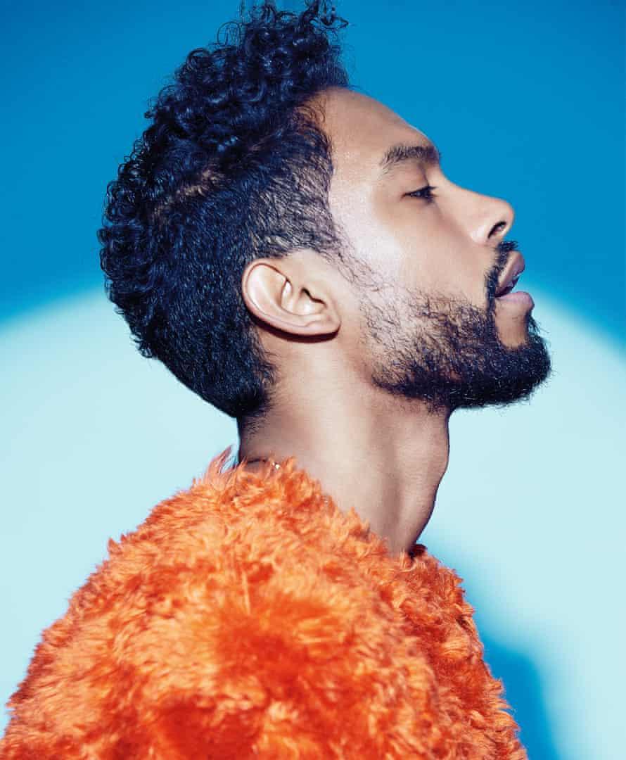 Portrait of Miguel in orange fluffy jumper
