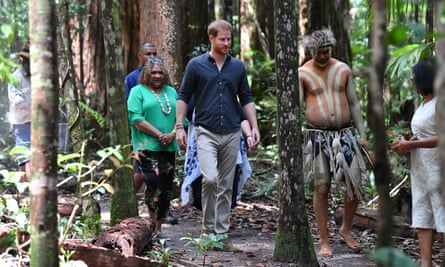 The duke of Sussex walks with members of the Butchulla people during the unveiling of the Queen's Commonwealth Canopy plaque at Pile Valley.